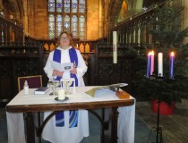 Rev Bee stood behind alter in front of choir stalls