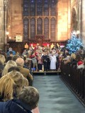 Congregation watching the nativity play performed