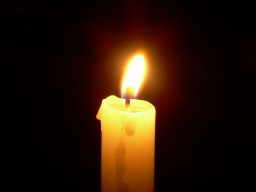 Single Lighted Candle