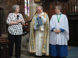 Chruch Warden saying farewell to Thomas and Catherine Shepherd